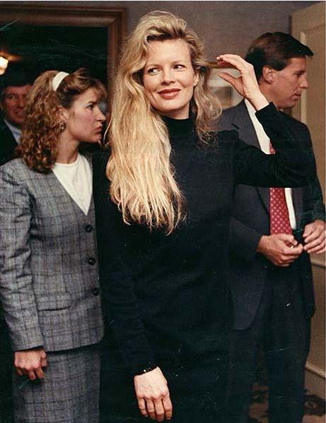 kim basinger arrives at the ritz carlton hotel in Buchead 1990
